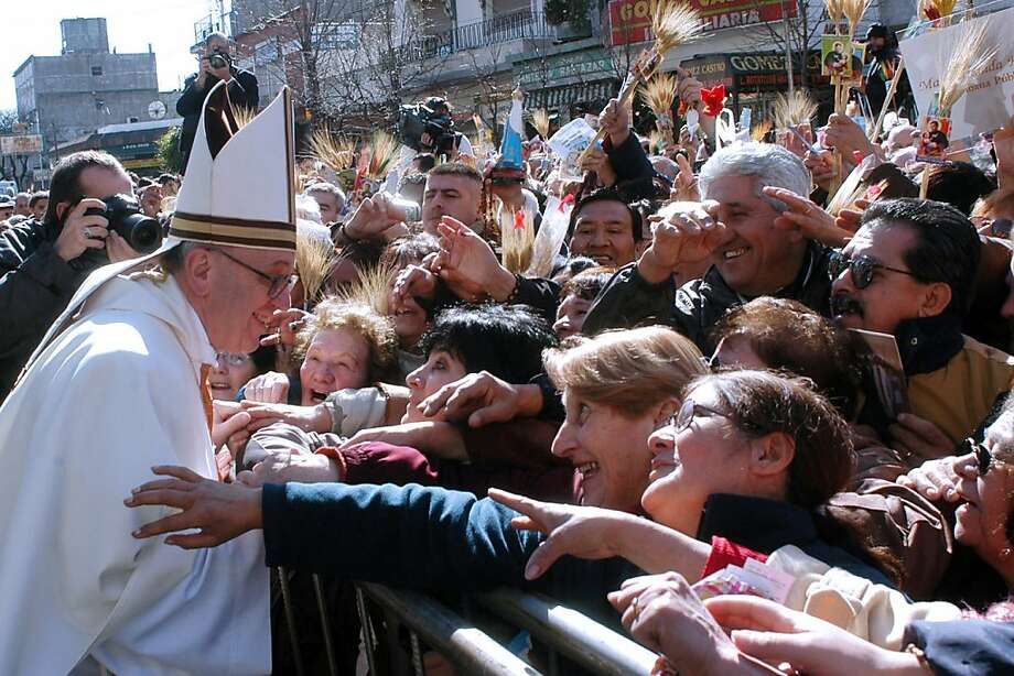 Undated file photo of Argentina's cardinal Jorge Mario Bergoglio greeting parishioners during the celebration of Saint Cajetan in Buenos Aires. Bergoglio has been elected Pope on March 13, 2013, to replace the frail Benedict XVI as leader of the world's 1.2 billon Catholics. Photo: Claudia Conteris, AFP/Getty Images