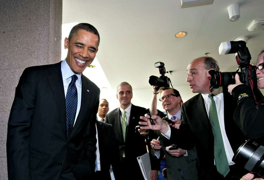 President Barack Obama turns to reporters as he leaves Capitol Hill in Washington, Wednesday, March 13, 2103, after his closed-door meeting with House Speaker John Boehner and Republican lawmakers to discuss the budget.  (AP Photo/J. Scott Applewhite) Photo: J. Scott Applewhite