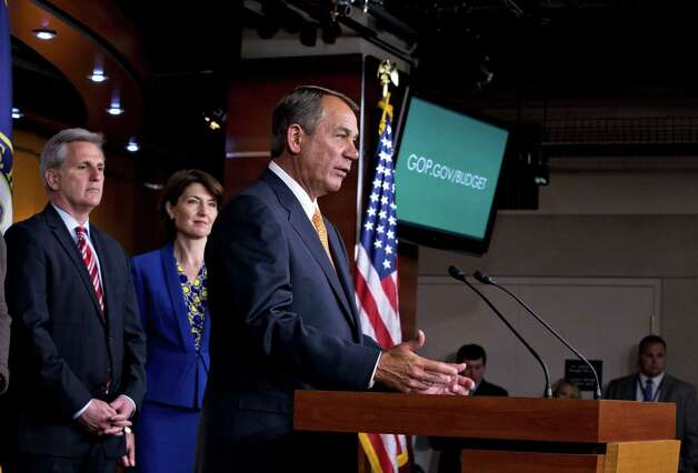 House Speaker John Boehner of Ohio, accompanied by House Majority Whip Kevin McCarthy of Calif., and Republican Conference Chair Rep. Cathy McMorris Rodgers, R-Wash., comments to reporters on Capitol Hill in Washington, Wednesday, March 13, 2013, following a closed-door meeting with President Barack Obama and House Republicans to discuss the budget. (AP Photo/J. Scott Applewhite) Photo: J. Scott Applewhite