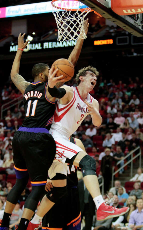 Rockets center Omer Asik is fouled by Markieff Morris of the Suns. Photo: Billy Smith II, Chronicle / © 2013 Houston Chronicle