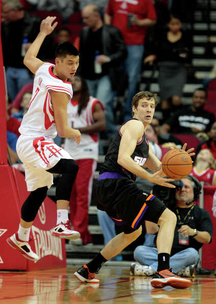 Goran Dragic of the Suns looks for a passing lane against Jeremy Lin of the Rockets.