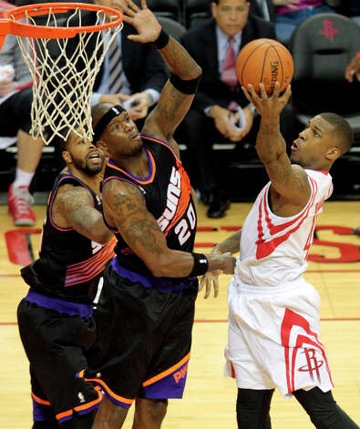 Thomas Robinson of the Rockets goes up for a layup against Suns center Jermaine O'Neal. Photo: Billy Smith II, Chronicle / © 2013 Houston Chronicle