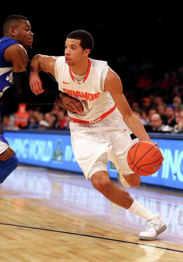 NEW YORK, NY - MARCH 13: Michael Carter-Williams #1 of the Syracuse Orange drives with the ball against Seton Hall Pirates in the second half during the second round of the Big East Tournament at Madison Square Garden on March 13, 2013 in New York City.  (Photo by Elsa/Getty Images) Photo: Elsa