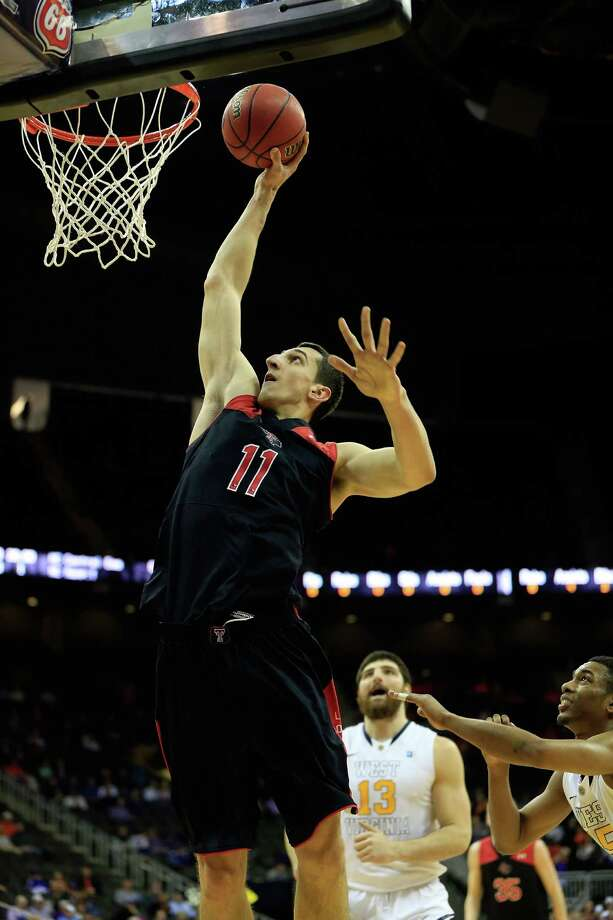 KANSAS CITY, MO - MARCH 13:  Dejan Kravic #11 of the Texas Tech Red Raiders shoots during the game as the Red Raiders defeat the West Virginia Mountaineers 71-69 to win their first round game of the 2013 Big 12 Men's Basketball Championship at Sprint Center on March 13, 2013 in Kansas City, Missouri.  (Photo by Jamie Squire/Getty Images) Photo: Jamie Squire