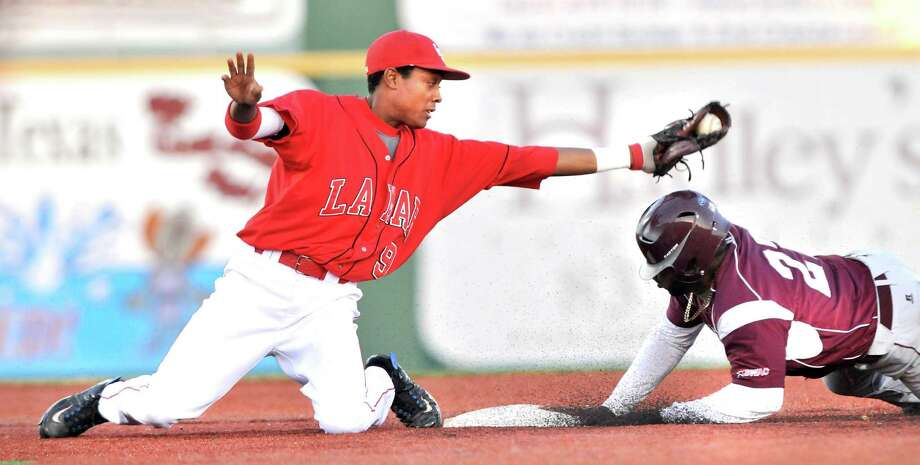 Lamar shortstop Sam Bumpers, left, looks on after tagging out Texas Southern's Marquis Curry in the top of the third inning Wednesday at Vincent-Beck Stadium. The Cardinals won 8-1. Mike Tobias/The Enterprise Photo: Mike Tobias