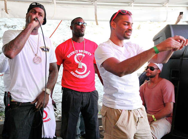 San Antonio Spurs' Stephen Jackson, aka Stak5, (from left)   is joined on stage by teammates DeJuan Blair, Gary Neal, and Patty Mills as he performs at the ÒSneakers & SpeakersÓ concert at Club De Ville during South by Southwest Wednesday March 13, 2013 in Austin, TX. Photo: Edward A. Ornelas, San Antonio Express-News / © 2013 San Antonio Express-News
