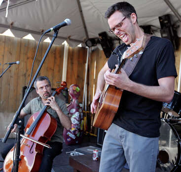 Steve Bernal (left) performs with Harper Bowman's Justin Harper Bowman at the Blind Pig Pub during South by Southwest Wednesday March 13, 2013 in Austin, TX. Photo: Edward A. Ornelas, San Antonio Express-News / © 2013 San Antonio Express-News