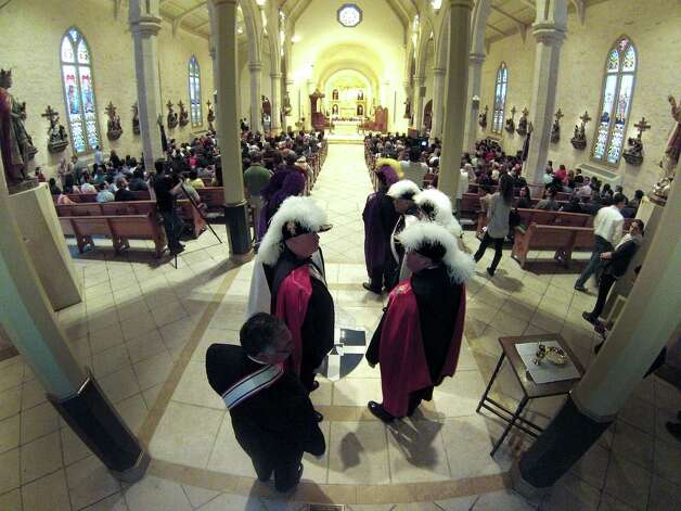 Members of the Knights of Columbus prepare to participate in a Mass at San Fernando Cathedral on Wednesday, March 13, 2013, to celebrate the naming of Jorge Mario Bergoglio of Argentina as the new Pope Francis I. Photo: Billy Calzada, San Antonio Express-News / San Antonio Express-News