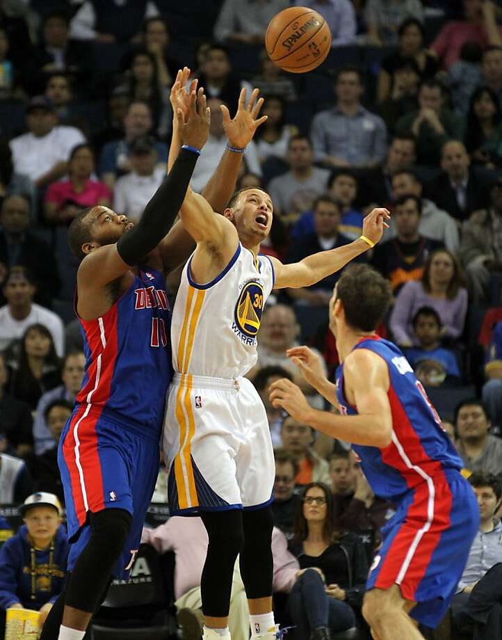 Golden State Warriors guard Stephen Curry (30) breaks up a pass between Detroit Pistons players in the first half of their NBA basketball game Wednesday, March 13, 2013, in Oakland Calif. Photo: Lance Iversen, The Chronicle