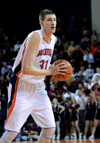 Bucknell's Mike Muscala looks to pass during the second half against Lafayette in an NCAA college basketball game for the Patriot League men's tournament title, Wednesday, March 13, 2013, in Lewisburg, Pa. Bucknell won 64-56. (AP Photo/Ralph Wilson) Photo: Ralph Wilson