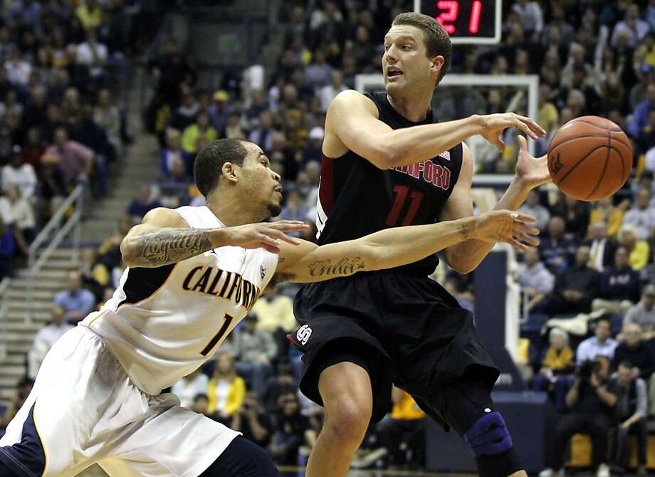 California guard Justin Cobbs (1) reaches in to knock the ball out of the hands of Stanford Andy Brown (11) in the second half of their NCAA basketball game Wednesday, March 6, 2013, in Berkeley, Calif. Photo: Lance Iversen, The Chronicle