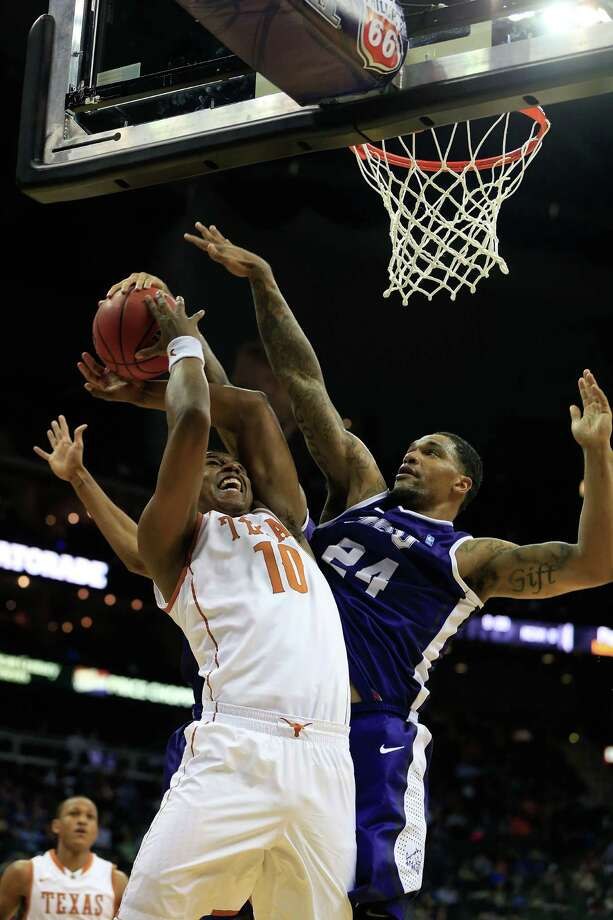 KANSAS CITY, MO - MARCH 13:  Jonathan Holmes #10 of the Texas Longhorns is fouled by Adrick McKinney #24 of the TCU Horned Frogs during the first round of the 2013 Big 12 Men's Basketball Championship at Sprint Center on March 13, 2013 in Kansas City, Missouri. Photo: Jamie Squire, Getty Images / 2013 Getty Images