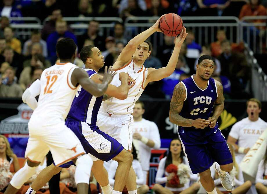 KANSAS CITY, MO - MARCH 13:  Ioannis Papapetrou #33 of the Texas Longhorns passes during the first round of the 2013 Big 12 Men's Basketball Championship against the TCU Horned Frogs at Sprint Center on March 13, 2013 in Kansas City, Missouri. Photo: Jamie Squire, Getty Images / 2013 Getty Images