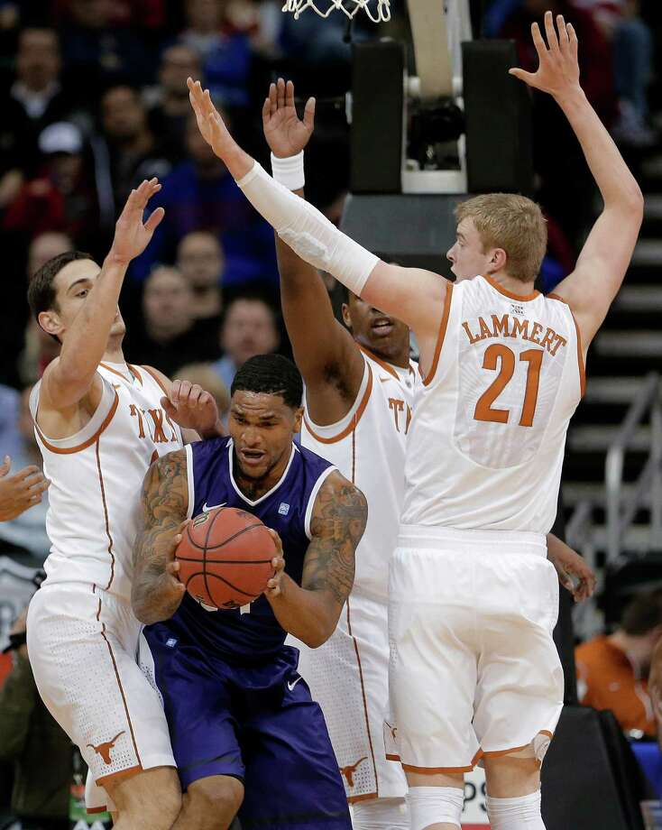 TCU forward Adrick McKinney, center, is trapped by Texas forward Connor Lammert (21) and forward Ioannis Papapetrou, left, during the first half an NCAA college basketball game in the Big 12 men's tournament Wednesday, March 13, 2013, in Kansas City, Mo. (AP Photo/Charlie Riedel) Photo: Charlie Riedel, Associated Press / AP