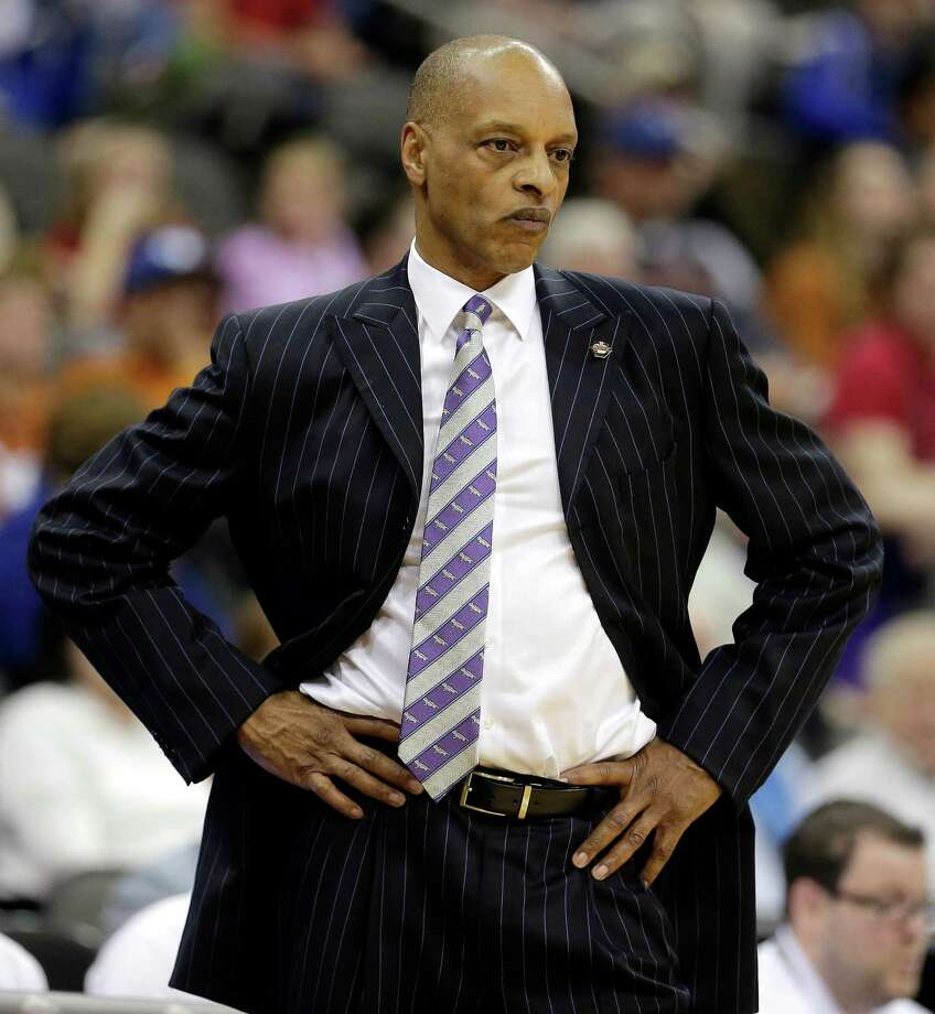 TCU head coach Trent Johnson watches during the second half of an NCAA college basketball game against Texas in the Big 12 tournament, Wednesday, March 13, 2013, in Kansas City, Mo. Texas won 70-57. (AP Photo/Charlie Riedel) Photo: Charlie Riedel, Associated Press / AP