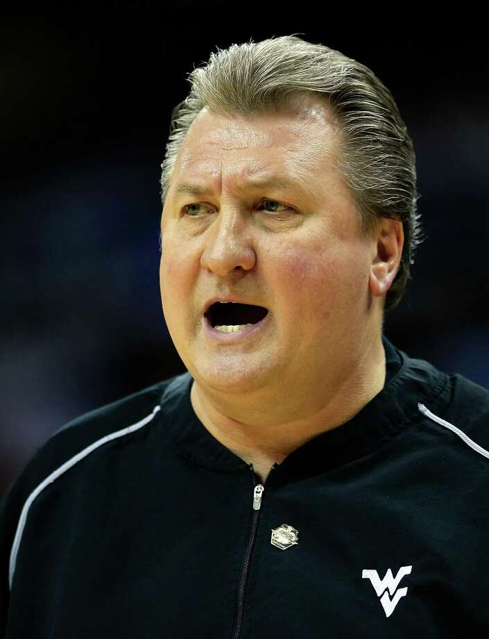 KANSAS CITY, MO - MARCH 13:  Head coach Bob Huggins of the West Virginia Mountaineers reacts from the bench during the first round of the 2013 Big 12 Men's Basketball Championship against the Texas Tech Red Raiders at Sprint Center on March 13, 2013 in Kansas City, Missouri. Photo: Jamie Squire, Getty Images / 2013 Getty Images
