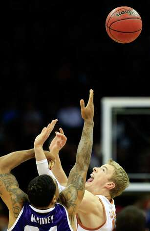 KANSAS CITY, MO - MARCH 13:  Connor Lammert #21 of the Texas Longhorns tips off against Adrick McKinney #24 of the TCU Horned Frogs during the first round of the 2013 Big 12 Men's Basketball Championship at Sprint Center on March 13, 2013 in Kansas City, Missouri. Photo: Jamie Squire, Getty Images / 2013 Getty Images