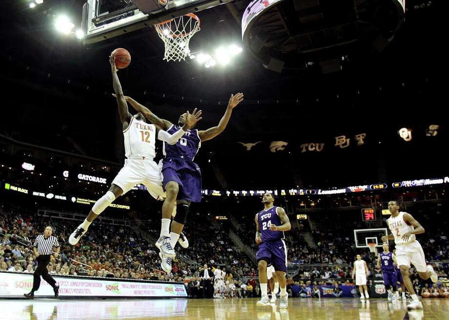 KANSAS CITY, MO - MARCH 13:  Myck Kabongo #12 of the Texas Longhorns is fouled by Charles Hill Jr. #0 of the TCU Horned Frogs on a fast break during the first round of the 2013 Big 12 Men's Basketball Championship at Sprint Center on March 13, 2013 in Kansas City, Missouri. Photo: Jamie Squire, Getty Images / 2013 Getty Images