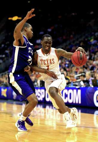 KANSAS CITY, MO - MARCH 13:  Sheldon McClellan #1 of the Texas Longhorns drives as Nate Butler Lind #21 of the TCU Horned Frogs defends during the first round of the 2013 Big 12 Men's Basketball Championship at Sprint Center on March 13, 2013 in Kansas City, Missouri. Photo: Jamie Squire, Getty Images / 2013 Getty Images