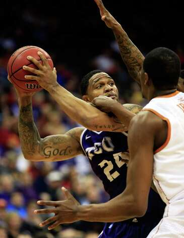 KANSAS CITY, MO - MARCH 13:  Adrick McKinney #24 of the TCU Horned Frogs looks to pass during the first round of the 2013 Big 12 Men's Basketball Championship against the Texas Longhorns at Sprint Center on March 13, 2013 in Kansas City, Missouri. Photo: Jamie Squire, Getty Images / 2013 Getty Images