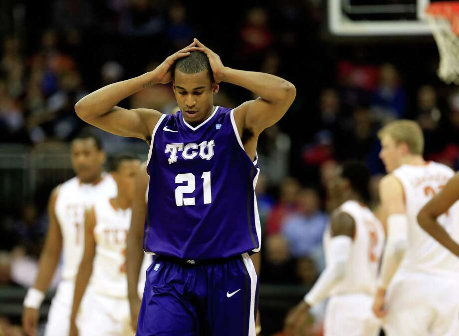 KANSAS CITY, MO - MARCH 13:  Nate Butler Lind #21 of the TCU Horned Frogs walks back upcourt after a foul during the first round of the 2013 Big 12 Men's Basketball Championship against the Texas Longhorns at Sprint Center on March 13, 2013 in Kansas City, Missouri. Photo: Jamie Squire, Getty Images / 2013 Getty Images