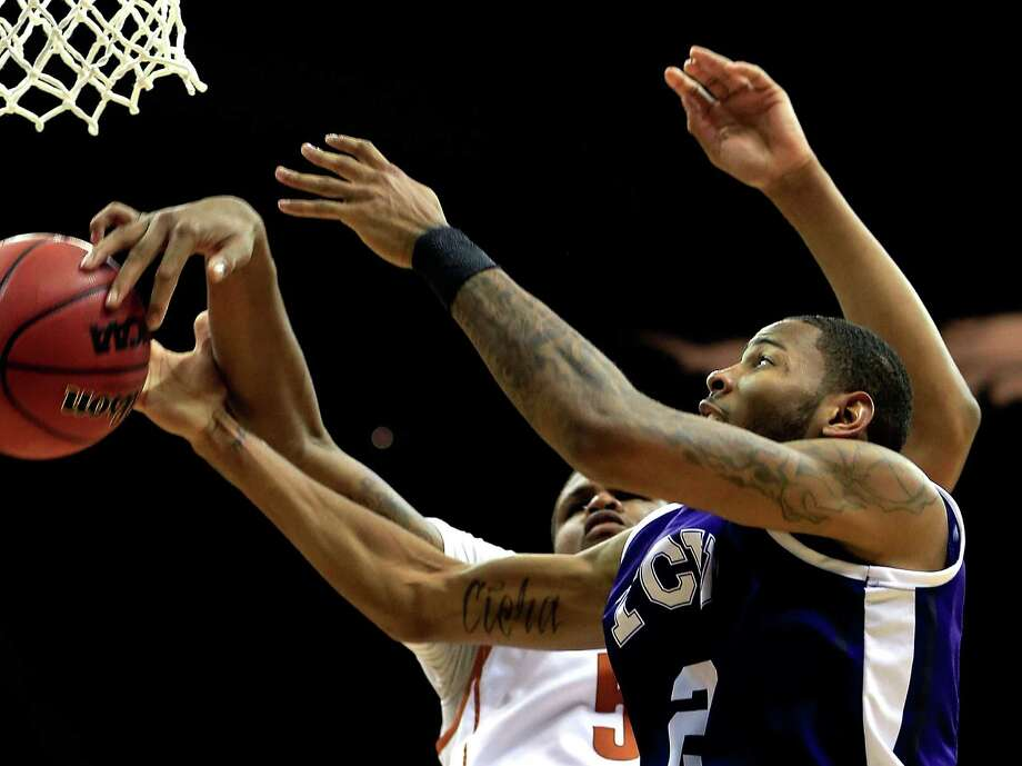 KANSAS CITY, MO - MARCH 13:  Connell Crossland #2 of the TCU Horned Frogs and Jaylen Bond #5 of the Texas Longhorns battle for a rebound during the first round of the 2013 Big 12 Men's Basketball Championship at Sprint Center on March 13, 2013 in Kansas City, Missouri. Photo: Jamie Squire, Getty Images / 2013 Getty Images