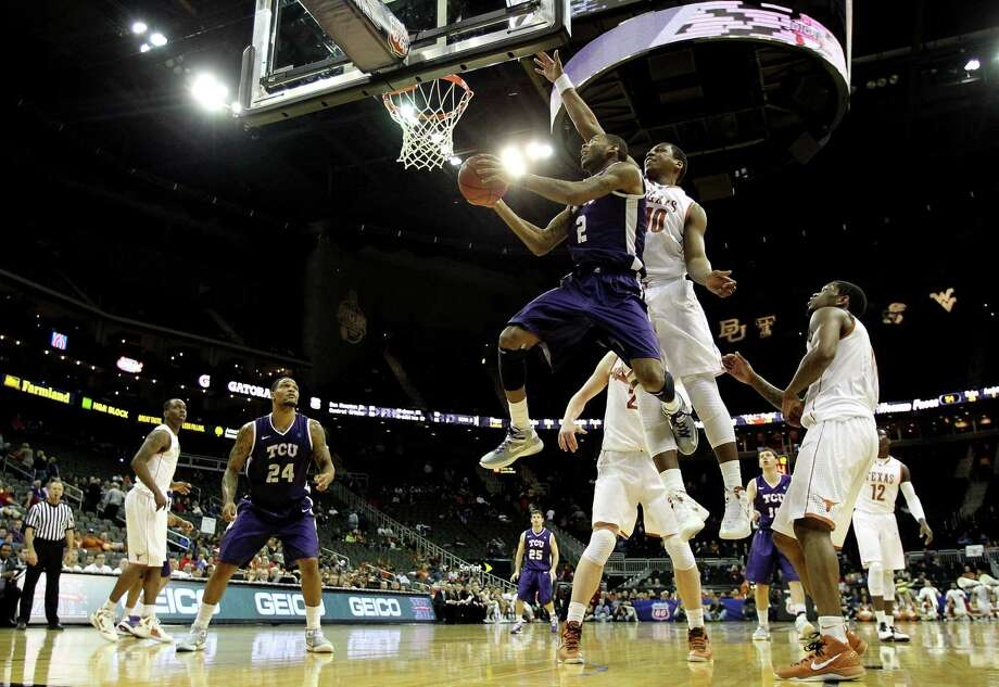 KANSAS CITY, MO - MARCH 13:  Connell Crossland #2 of the TCU Horned Frogs shoots on a fast break as Jonathan Holmes #10 of the Texas Longhorns defends during the first round of the 2013 Big 12 Men's Basketball Championship at Sprint Center on March 13, 2013 in Kansas City, Missouri. Photo: Jamie Squire, Getty Images / 2013 Getty Images