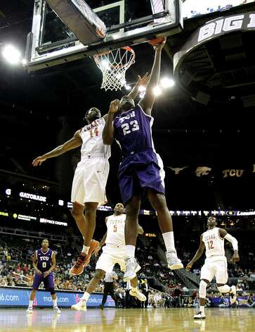 KANSAS CITY, MO - MARCH 13:  Devonta Abron #23 of the TCU Horned Frogs shoots on a fast break as Julien Lewis #14 of the Texas Longhorns defends during the first round of the 2013 Big 12 Men's Basketball Championship at Sprint Center on March 13, 2013 in Kansas City, Missouri. Photo: Jamie Squire, Getty Images / 2013 Getty Images