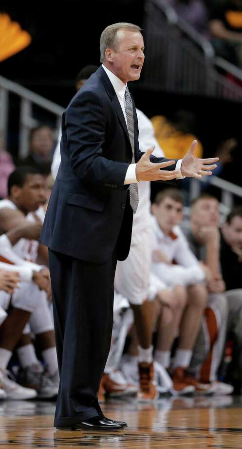 Texas coach Rich Barnes talks to his players during the first half an NCAA college basketball game against TCU in the Big 12 men's tournament Wednesday, March 13, 2013, in Kansas City, Mo. (AP Photo/Charlie Riedel) Photo: Charlie Riedel, Associated Press / AP