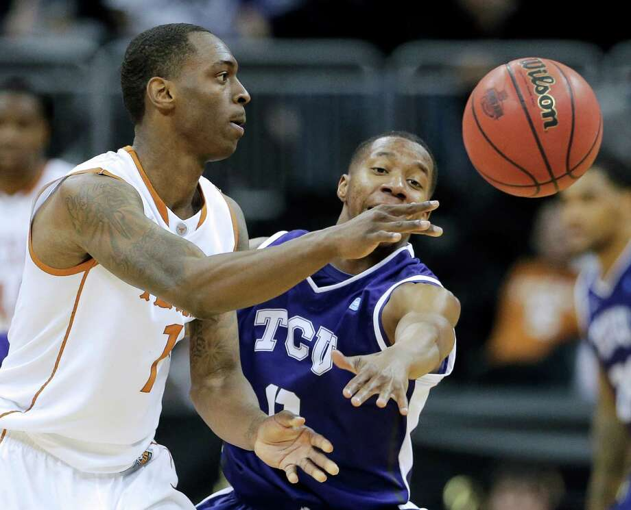 Texas guard Sheldon McClellan (1) passes under pressure from TCU guard Charles Hill Jr. (0) during the second half an NCAA college basketball game in the Big 12 men's tournament Wednesday, March 13, 2013, in Kansas City, Mo. Texas won the game 70-57. (AP Photo/Charlie Riedel) Photo: Charlie Riedel, Associated Press / AP