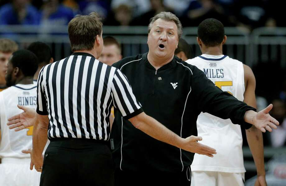 West Virginia coach Bob Huggins argues a call with an official during the first half an NCAA college basketball game against Texas Tech in the Big 12 men's tournament Wednesday, March 13, 2013, in Kansas City, Mo. (AP Photo/Charlie Riedel) Photo: Charlie Riedel, Associated Press / AP