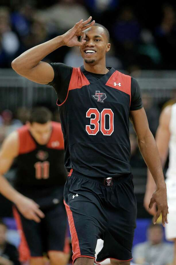 Texas Tech forward Jaye Crockett celebrates after making a 3-point shot during the first half an NCAA college basketball game against West Virginia in the Big 12 men's tournament Wednesday, March 13, 2013, in Kansas City, Mo. (AP Photo/Charlie Riedel) Photo: Charlie Riedel, Associated Press / AP