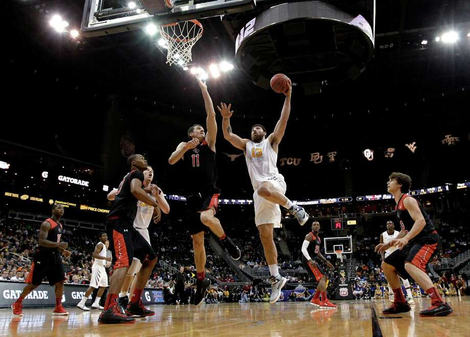 West Virginia forward Deniz Kilicli (13) puts up shot past Texas Tech forward Dejan Kravic (11) during the first half an NCAA college basketball game in the Big 12 men's tournament Wednesday, March 13, 2013, in Kansas City, Mo. (AP Photo/Charlie Riedel) Photo: Charlie Riedel, Associated Press / AP
