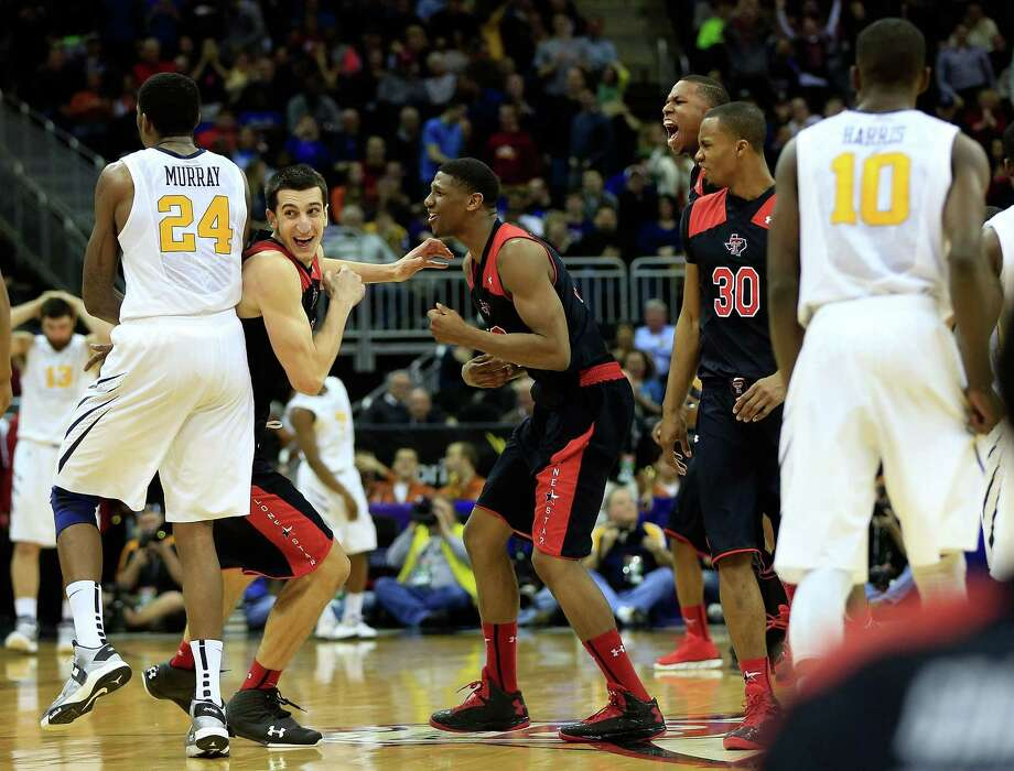 KANSAS CITY, MO - MARCH 13:  Dejan Kravic #11 of the Texas Tech Red Raiders celebrates with teammates after scoring the final basket as the Red Raiders defeated the West Virginia Mountaineers 71-69 to win thier first round game of the 2013 Big 12 Men's Basketball Championship at Sprint Center on March 13, 2013 in Kansas City, Missouri. Photo: Jamie Squire, Getty Images / 2013 Getty Images