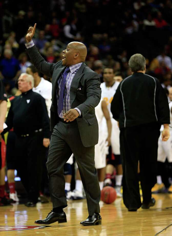 KANSAS CITY, MO - MARCH 13:  Head coach Chris Walker of the Texas Tech Red Raiders celebrates as the Red Raiders defeated the West Virginia Mountaineers 71-69 to win thier first round game of the 2013 Big 12 Men's Basketball Championship at Sprint Center on March 13, 2013 in Kansas City, Missouri. Photo: Jamie Squire, Getty Images / 2013 Getty Images