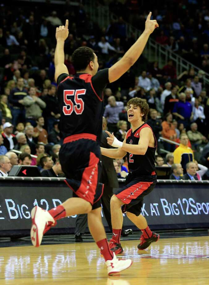KANSAS CITY, MO - MARCH 13:  Dusty Hannahs #2 of the Texas Tech Red Raiders celebrates as the Red Raiders defeat the West Virginia Mountaineers 71-69 to win their first round game of the 2013 Big 12 Men's Basketball Championship at Sprint Center on March 13, 2013 in Kansas City, Missouri. Photo: Jamie Squire, Getty Images / 2013 Getty Images