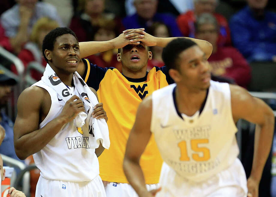 KANSAS CITY, MO - MARCH 13:  West Virginia Mountaineers players react as the Texas Tech Red Raiders defeat the Mountaineers 71-69 to win the first round game of the 2013 Big 12 Men's Basketball Championship at Sprint Center on March 13, 2013 in Kansas City, Missouri. Photo: Jamie Squire, Getty Images / 2013 Getty Images