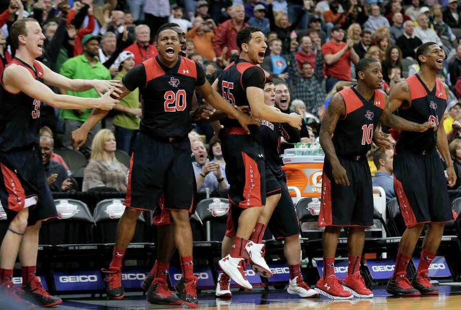Texas Tech's bench celebrates after Dejan Kravic made the game-winning basket during the second half an NCAA college basketball game against West Virginia in the Big 12 men's tournament Wednesday, March 13, 2013, in Kansas City, Mo. Texas Tech won 71-69. (AP Photo/Charlie Riedel) Photo: Charlie Riedel, Associated Press / AP