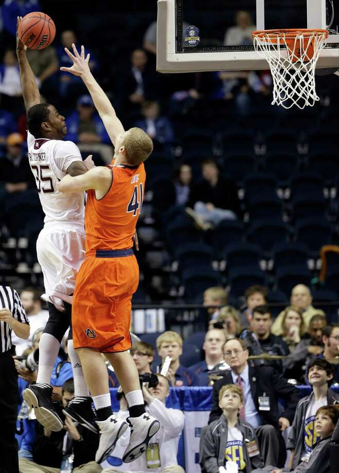 Texas A&M forward Ray Turner (35) shoots against Auburn center Rob Chubb (41) during the first half of an NCAA college basketball game at the Southeastern Conference tournament in Nashville, Tenn., Wednesday, March 13, 2013. (AP Photo/Dave Martin) Photo: Dave Martin, Associated Press / AP