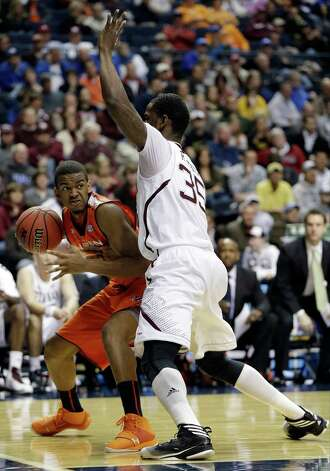 Auburn guard Josh Wallace, left, drives as Texas A&M forward Ray Turner (35) defends during the first half of an NCAA college basketball game at the Southeastern Conference tournament in Nashville, Tenn., Wednesday, March 13, 2013. (AP Photo/Dave Martin) Photo: Dave Martin, Associated Press / AP