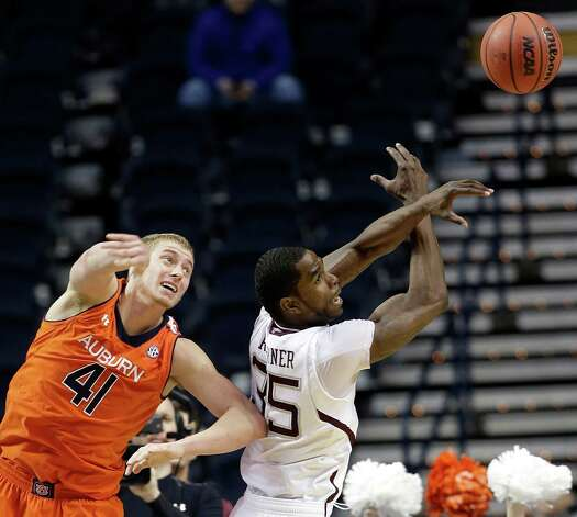 Auburn center Rob Chubb (41) and Texas A&M forward Ray Turner (35) vie for a loose ball during the second half of an NCAA college basketball game at the Southeastern Conference tournament, Wednesday, March 13, 2013, in Nashville, Tenn. (AP Photo/Dave Martin) Photo: Dave Martin, Associated Press / AP