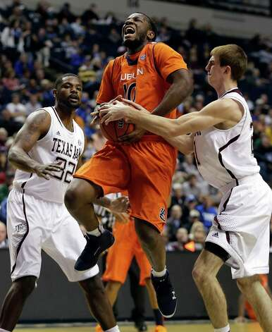 Auburn guard Jordan Price (10) heads to the basket as Texas A&M guard Alex Caruso (21) and forward Kourtney Roberson (32) defend during the first half of an NCAA college basketball game at the Southeastern Conference tournament in Nashville, Tenn., Wednesday, March 13, 2013. (AP Photo/Dave Martin) Photo: Dave Martin, Associated Press / AP