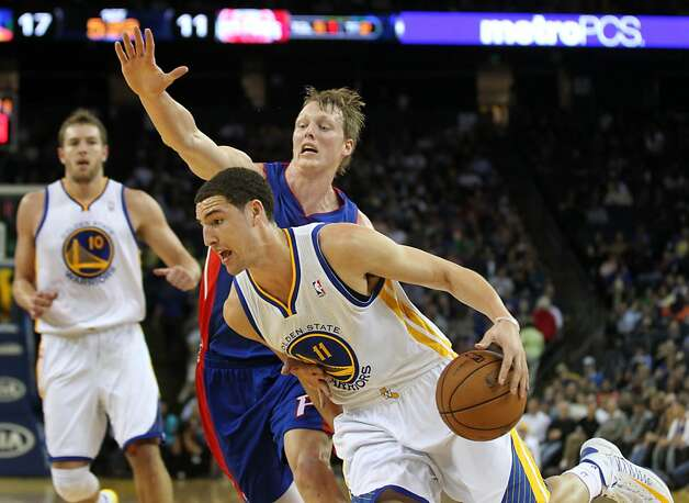 Golden State Warriors guard Klay Thompson (11) drives past Detroit Pistons defenders in the first half of their NBA basketball game Wednesday, March 13, 2013, in Oakland Calif. Photo: Lance Iversen, The Chronicle