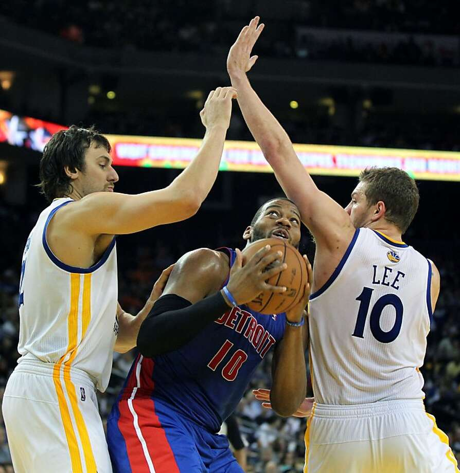 Detroit Pistons Greg Monroe (10) gets double teamed by Golden State Warriors center Andrew Bogut (12) and Davis Lee (10) in the second half of their NBA basketball game Wednesday, March 13, 2013, in Oakland Calif. Photo: Lance Iversen, The Chronicle