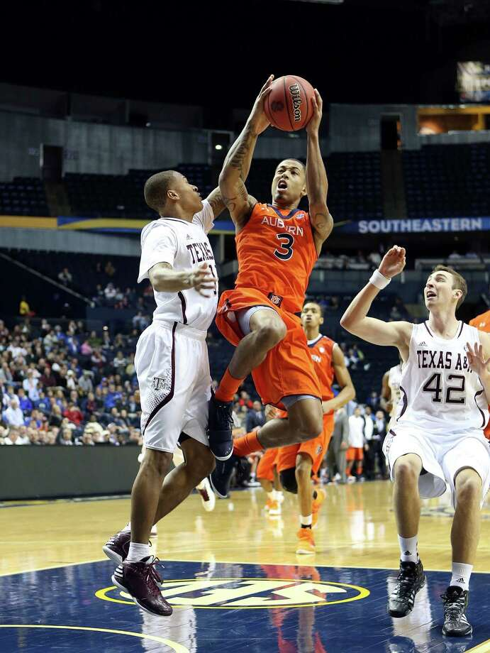 NASHVILLE, TN - MARCH 13:  Chris Denson #3 of the Auburn Tigers shoots the ball against the Texas A&M Aggies during the first round game of the Southeastern Conference Tournament at Bridgestone Arena on March 13, 2013 in Nashville, Tennessee. Photo: Andy Lyons, Getty Images / 2013 Getty Images