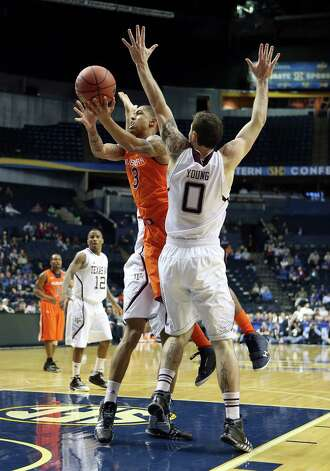 NASHVILLE, TN - MARCH 13:  Chris Denson #3 of the Auburn Tigers shoots the ball while defended by Andrew Young # 0 of the Texas A&M Aggies during the first round game of the Southeastern Conference Tournament at Bridgestone Arena on March 13, 2013 in Nashville, Tennessee. Photo: Andy Lyons, Getty Images / 2013 Getty Images