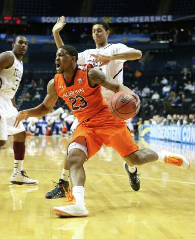 NASHVILLE, TN - MARCH 13:  Frankie Sullivan #23 of the Auburn Tigers dribbles the ball against the Texas A&M Aggies during the first round game of the Southeastern Conference Tournament at Bridgestone Arena on March 13, 2013 in Nashville, Tennessee. Photo: Andy Lyons, Getty Images / 2013 Getty Images