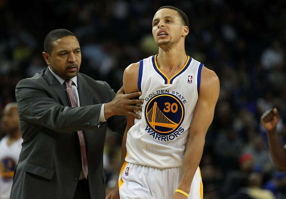 Golden State Warriors head coach Mark Jackson talks with his point guard Stephen Curry (30) midway through the third period of their NBA basketball game with the Detroit Pistons Wednesday, March 13, 2013, in Oakland Calif. Photo: Lance Iversen, The Chronicle