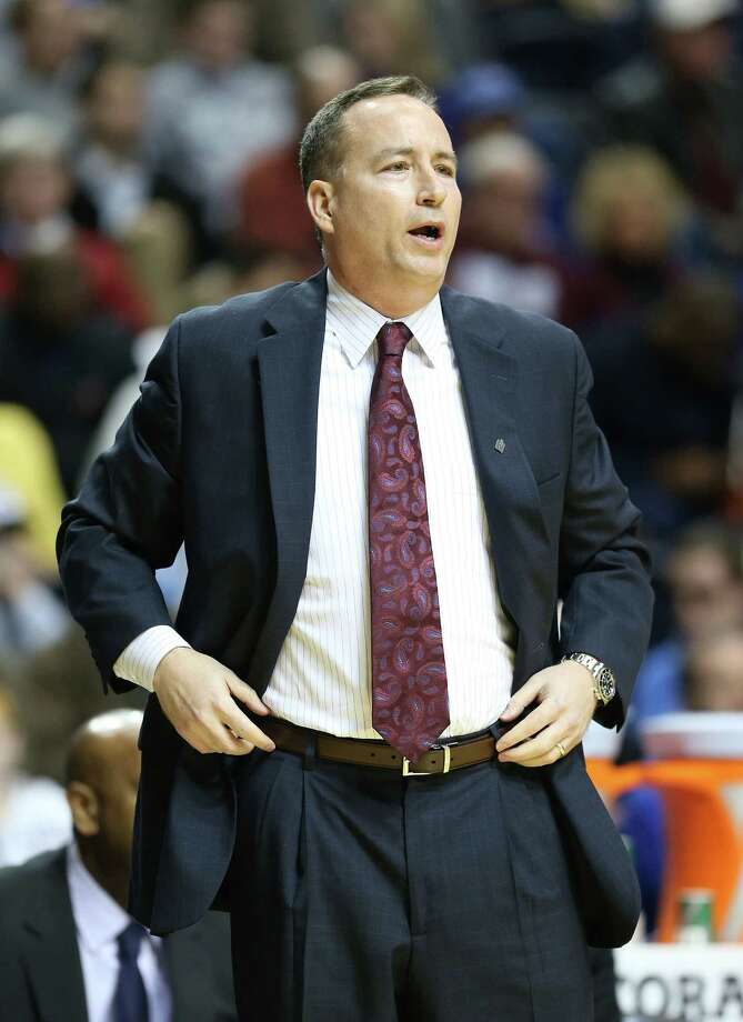 NASHVILLE, TN - MARCH 13:  Billy Kennedy the head coach of the Texas A&M Aggies gives instructions to his team during the game against the Auburn Tigers during the first round game of the Southeastern Conference Tournament at Bridgestone Arena on March 13, 2013 in Nashville, Tennessee. Photo: Andy Lyons, Getty Images / 2013 Getty Images