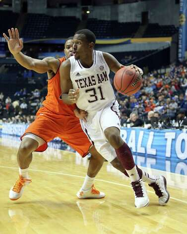 NASHVILLE, TN - MARCH 13:  Elston Turner #31 of the Texas A&M Aggies dribbles the ball against the Auburn Tigers during the first round game of the Southeastern Conference Tournament at Bridgestone Arena on March 13, 2013 in Nashville, Tennessee. Photo: Andy Lyons, Getty Images / 2013 Getty Images